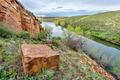 old sandstone quarry on lake shore - PhotoDune Item for Sale