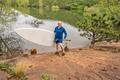 senior paddler with SUP paddleboard - PhotoDune Item for Sale