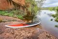 stand up paddleborad on lake shore - PhotoDune Item for Sale