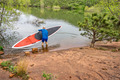 senior paddler launching  SUP paddleboard - PhotoDune Item for Sale