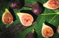 Figs and leaves on wood - PhotoDune Item for Sale