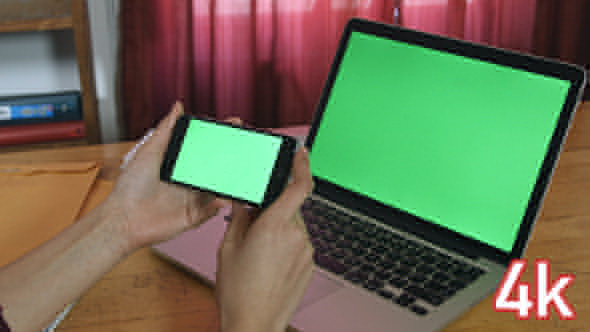 Girl Holding Phone with Laptop Green Screen