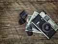 old vintage camera closeup on wooden background - PhotoDune Item for Sale