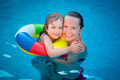 Child and woman playing in swimming pool - PhotoDune Item for Sale