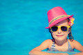 Child playing in swimming pool - PhotoDune Item for Sale