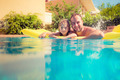 Child and father playing in swimming pool - PhotoDune Item for Sale