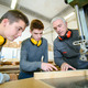Male students in a woodwork class - PhotoDune Item for Sale