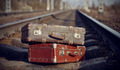 The image of two vintage suitcases on railway tracks. - PhotoDune Item for Sale