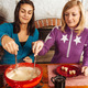 Two friends eating fondue - PhotoDune Item for Sale