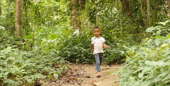 Kid Walking On Forest Trail