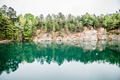 cloudy skies and reflections at a quarry - PhotoDune Item for Sale