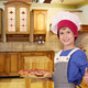 boy chef with pizza and thumb up in kitchen - PhotoDune Item for Sale