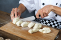Cook cuts pizza dough - PhotoDune Item for Sale