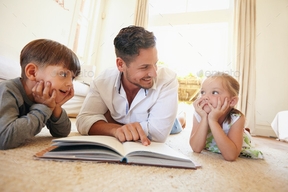 Young man with two kids reading a story book