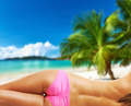 Woman topless on beautiful beach at Seychelles - PhotoDune Item for Sale