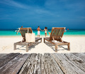 Couple in white relax on a beach at Maldives - PhotoDune Item for Sale