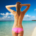 Woman topless on tropical beach at Maldives - PhotoDune Item for Sale