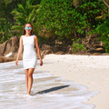 Woman wearing dress on beach at Seychelles - PhotoDune Item for Sale