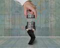 Man carrying concrete blocks with hand stacking business doodles wall - PhotoDune Item for Sale