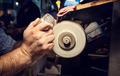 Craftsman during sanding of a crystal ashtrays - PhotoDune Item for Sale