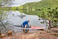 senior paddler launching paddleboard - PhotoDune Item for Sale
