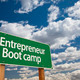 Entrepreneur Boot Camp Green Road Sign and Dramatic Clouds Background. - PhotoDune Item for Sale