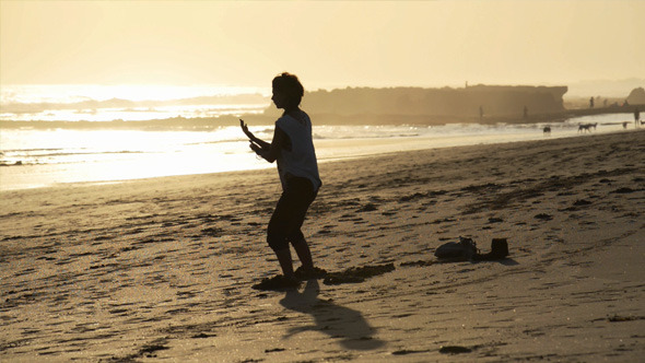 VideoHive Woman Practicing Yoga on Sunset Beach 11539779