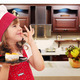 happy little girl cook with cake and ok hand sign in kitchen - PhotoDune Item for Sale
