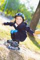 Cute boy rollerblading near the playground - PhotoDune Item for Sale