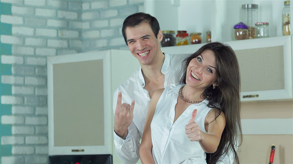Newly Married Couple Are Show Thumbs Up