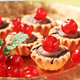 Chocolate filled tartlets topped with glace cherries - PhotoDune Item for Sale