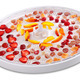 Slices of fruits and berries on dehydrator tray - PhotoDune Item for Sale