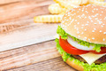 Hamburger on wood table ,sun flare filter effect - PhotoDune Item for Sale
