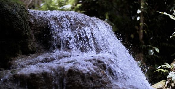 Beautiful Nature Waterfall On A Small Lake