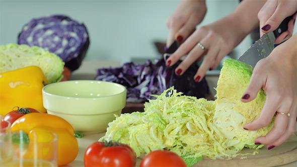 Smiling Girlfriends Sliced Vegetables For Salads