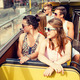 group of smiling friends traveling by tour bus - PhotoDune Item for Sale