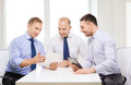 three smiling businessmen with tablet pc in office - PhotoDune Item for Sale