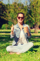smiling young girl with cup of coffee in park - PhotoDune Item for Sale