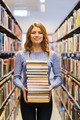 happy student girl or woman with books in library - PhotoDune Item for Sale