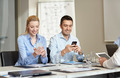 smiling business people with smartphones in office - PhotoDune Item for Sale