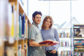 happy student couple with books in library - PhotoDune Item for Sale