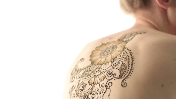 View Of Woman's Back With Beautiful Henna Pattern