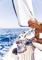 Handsome man on sailboat - PhotoDune Item for Sale