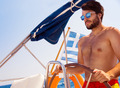 Handsome man driving sailboat - PhotoDune Item for Sale