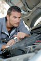 Man fixing a car engine - PhotoDune Item for Sale