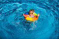 Happy child playing in swimming pool - PhotoDune Item for Sale