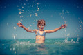 Happy child playing in the sea - PhotoDune Item for Sale