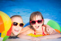Happy children in the swimming pool - PhotoDune Item for Sale