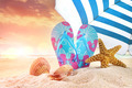 Pair of flip- flops in the sand with starfish - PhotoDune Item for Sale