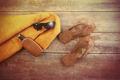 Orange towel and beach items on wood - PhotoDune Item for Sale
